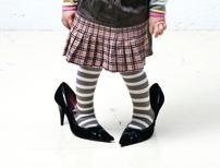 Little girl in adult high heels