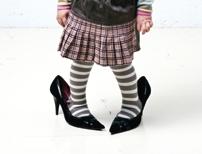 Little girl in adult high heels